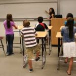 Kids standing at desk learning about a healthy lifestyle